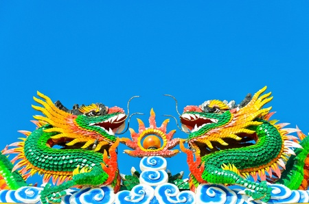 twin chinese dragon in blue sky Stock Photo