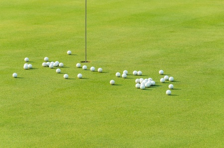 group of practice golf ball on green
