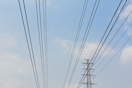 high voltage electrical power wire and post in blue cloud sky Stock Photo - 13328806