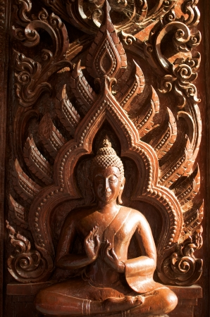thai traditional wood carve buddha image  photo