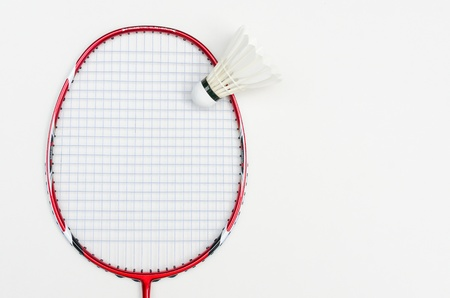 badminton racket in red color with shuttlecock and light blue string in front view on white background