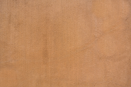 rough plaster cement wall in terracotta earth tone color photo