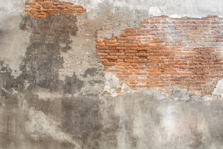 brick plaster cement partial crack wall Stock Photo