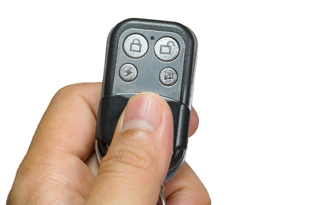 hand holding security remote control isolate on white background