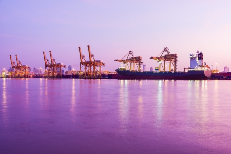 early morning twilight at industrial cargo harbour along river