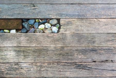 legno striscia ruvida con mattoni e pietra di piccole dimensioni inserto Archivio Fotografico