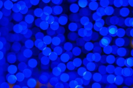 blu tondo dot pattern casuale in fondo scuro