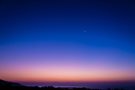 early morning: beautiful early morning dawn twilight with moon and star at the sea