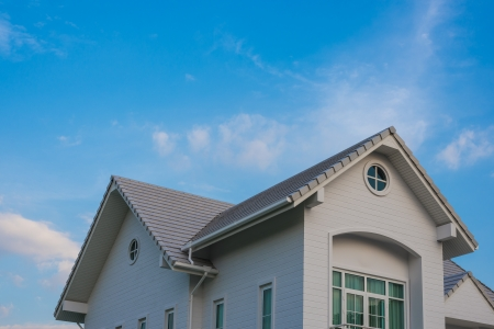 twin house: twin gable roof house under blue cloud sky