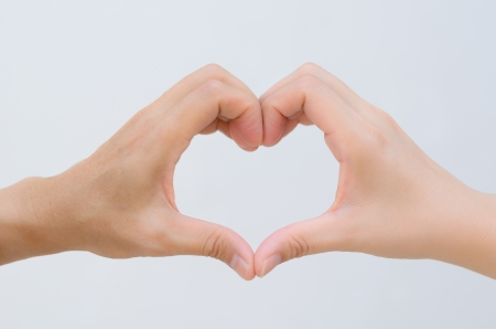 two hands of man and women together become one heart shape form in white background Stock Photo
