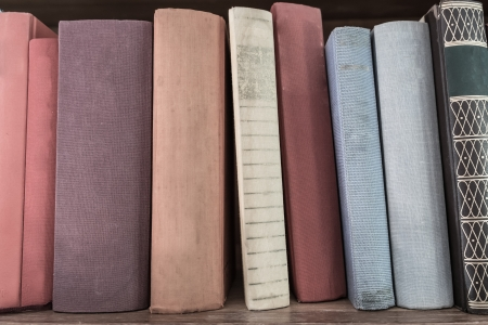 vetical: old book vetical stack on wood shelf