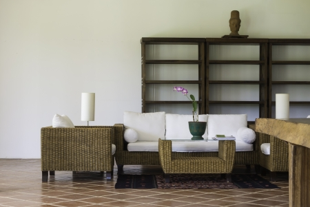 rattan and wood furniture with terracotta floor tile interior decoration oriental style Editorial