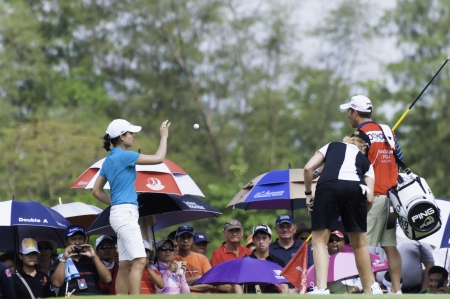 PATTAYA THAILAND-FEBRUARY 21-Lorena Ochoa of Mexico grabs golf ball from caddy on green in Final Round of Honda LPGA Thailand 2010 between February 18 - 21 at Siam Country Club Old Course in Pattaya, Thailand Editorial