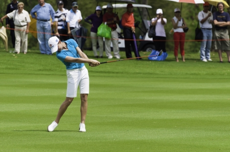 PATTAYA THAILAND-FEBRUARY 21-Lorena Ochoa of Mexico hits fairway shot in Final Round of Honda LPGA Thailand 2010 between February 18 - 21 at Siam Country Club Old Course in Pattaya, Thailand Editorial