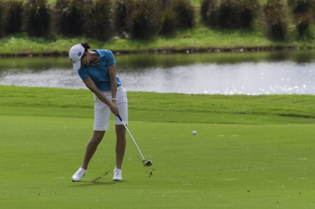 PATTAYA THAILAND-FEBRUARY 21-Lorena Ochoa of Mexico hits iron shot from fairway in Final Round of Honda LPGA Thailand 2010 between February 18 - 21 at Siam Country Club Old Course in Pattaya, Thailand Editorial