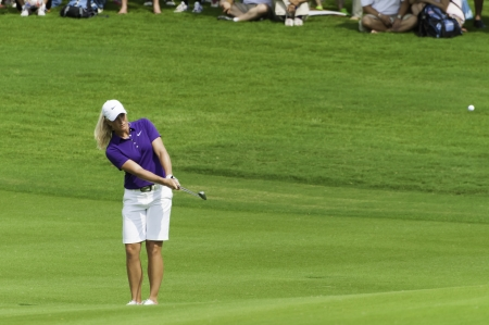 PATTAYA THAILAND - FEBRUARY 21-Suzann Pettersen of Norway chips golf ball to green in Final Round of Honda LPGA Thailand 2010 between February 18 - 21 at Siam Country Club Old Course in Pattaya, Thailand Editorial