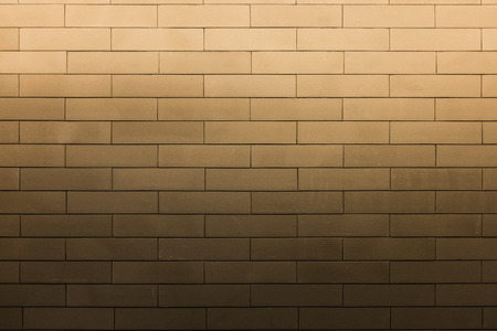 bright light flood on top of brown texture brick wall pattern Stock Photo