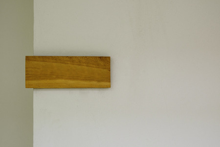 decorative horizontal wood plate sign on plain white wall background