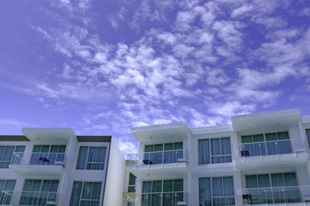 facade of modern low rise architecture in blue sky