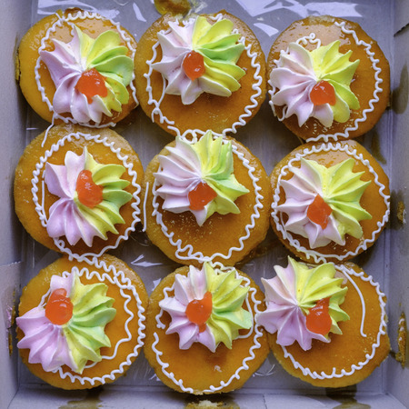 thai style orange cup cake with hand made colorful decoration in paper box Stock Photo