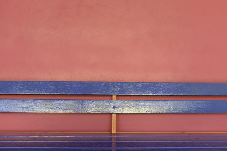 bright blue wood long bench on vivid pink color wall background Stock Photo