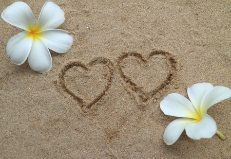 Double heart drawn on sand Stock Photo - 11308057
