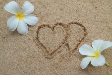 Double heart drawn on sand Stock Photo - 11970365