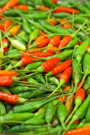 Many red and green chili peppers Stock Photo