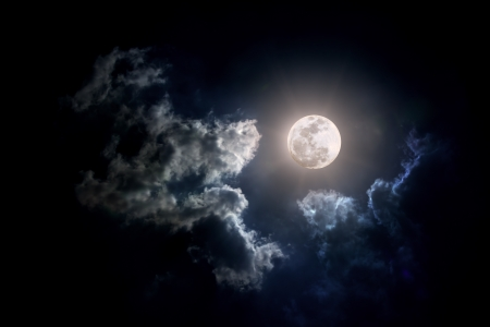 moody sky: Moon on Cloudy day