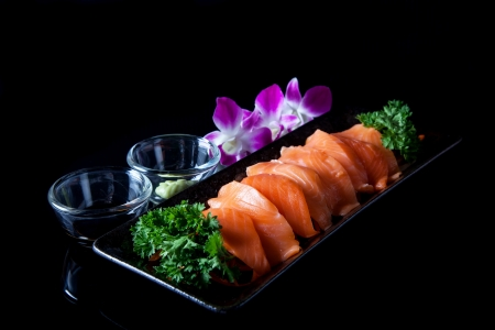 wasabi: Salmon sashimi served with soy sauce and wasabi.