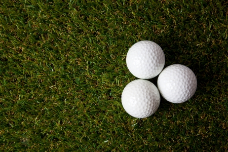 off course: Golf ball on green. Stock Photo