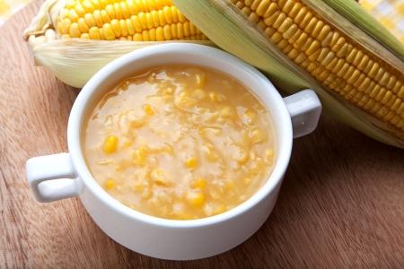 chowder: Corn chowder and fresh corn on wood butcher. Stock Photo