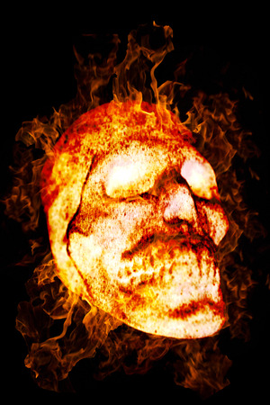 Burning Skull as a symbol of the dead or dangers. Isolated on a black background