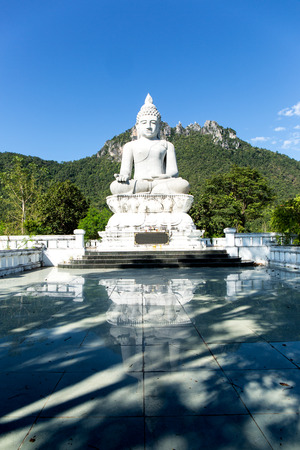 buddha image: Big buddha image in front of little pagoda on the mountain.