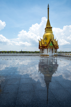 reflexion: Little pagoda in Thai temple with blue sky and reflexion on the floor.
