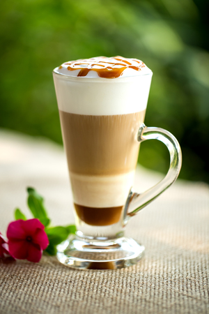 Fancy latte coffee in glass jar. Stock Photo