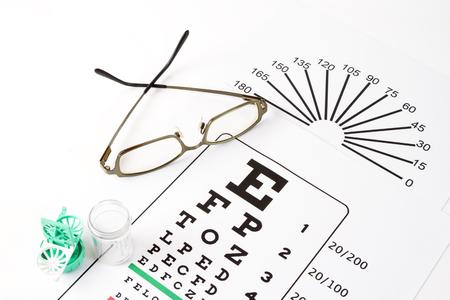 The eye glasses on medical eye chart. Stock Photo