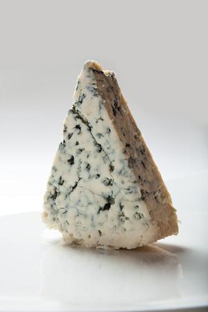 stilton: A piece of blue cheese.