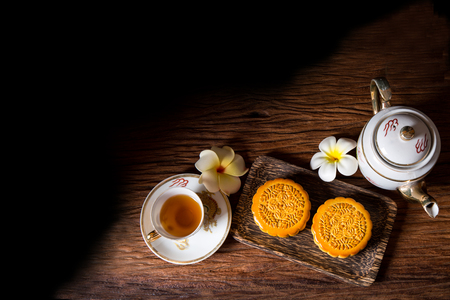 Moon cakes - food for Chinese mid-autumn festival with a cup of tea