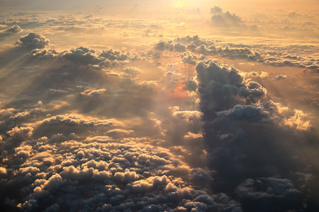 Cloudscape view at dawn from airplane window.