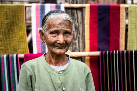 Kyi Chaung, Mrauk U, Rakhine state, Myanmar - Jan 3, 2017: An old Chin woman with tattooed face in Chin village.