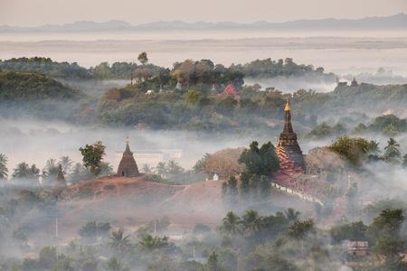 Morning mist over pagoda in Mrauk-u, Myanmar.