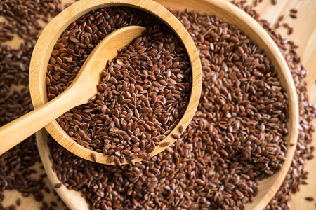 Brown flaxseed, organic food for healthy eating.