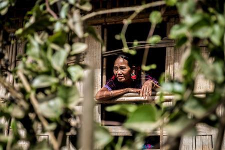 Kyi Chaung, Mrauk U, Rakhine, Myanmar - Jan 3, 2017: An old Chin woman with tattooed face in Chin village.