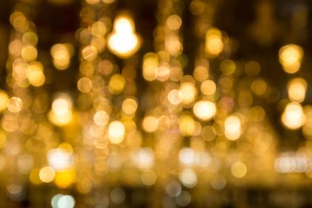 Golden bokeh shinny on dark background.