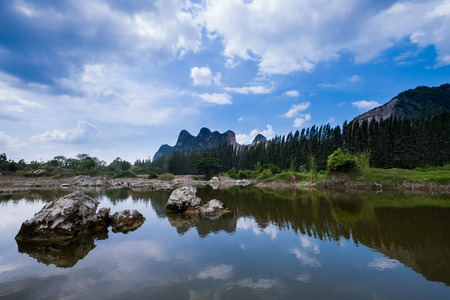 Landscape of mountain view look like man head reflex on the lake, middle of Thailand.