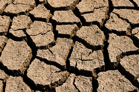 Dry and cracked soil in summer on south east asia.