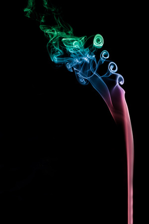 The color smoke moving on dark background. 写真素材