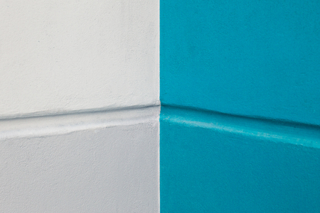 mottle: blue and white painted on cement wall Stock Photo