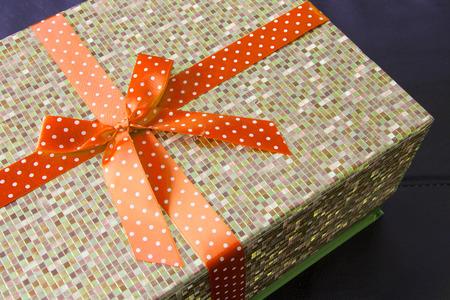 Gift box with orange bow ribbon